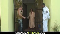 Sexy grandma swallows black and white cocks at once