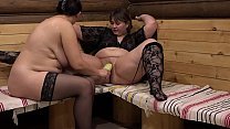 Two mature fat lesbians have fun with a wide zucchini, pussy licking and stretching a wet hole. thumbnail