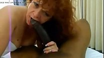 White broad takes a long black dick in her throat