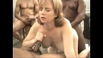 Redhead Dawn in an interracial creampie gangbang