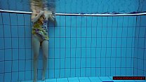 Blonde in a dress in a pool Image