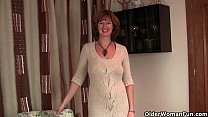 Mature redhead mom gets finger fucked by photog...