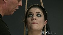BDSM XXX Black haired sub has breasts tied to the ceiling before anal hook