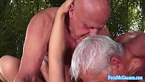 Redhead minx sucks two limp old dicks