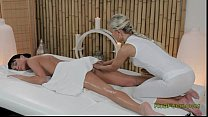 Blonde masseuse rubbing and oiling pussy to brunette hottie thumbnail