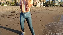 Wet shoot on a public beach with Crazy Model. Risky outdoor masturbation. Foot fetish. Pee in jeans.