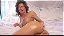 beautiful mature woman assumes her beautiful as...