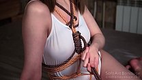 Sensitive touching in color rope bondage