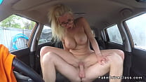 Couple banging in fake driving school car