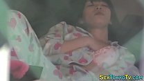 Japanese babe writhes around as she fingers