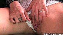 Image: Redheaded mature mom plays with her nipples and pussy