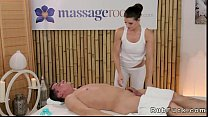 Hot masseuse oils and rubs dude with her gorgeous body Image