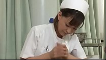 Sexy japanese nurse giving patient a handjob صورة
