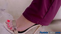 Petite teen gives footjob video