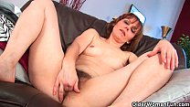 Older woman Mylene finger fucks her full bushed pussy