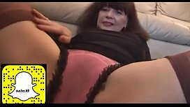 Busty mature with hairy pussy in mini skirt plays with panties and teases