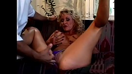 Mature blonde Michelle St. James is an expert at sucking young stud'_s cock