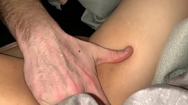 Rubbing her pussy on the couch under the sheets.