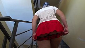 Peeping under the skirt. Juicy PAWG and hairy pussy on the stairs and on the public balcony. Amateur fetish.
