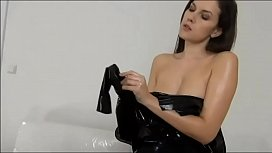 Woman latex dressup with warm beauty oel and comming feelings