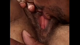 Curly haired black Joi  babe rides a hard long dong on the bed