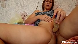 Redhead mom uses a sex toy on herself