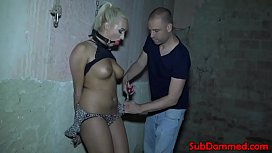 Blonde bdsm sub restrained...