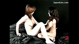 2 Busty Asian Girls Kissing Rubbing Their Pussies Using Oil On The Bed On The Bed