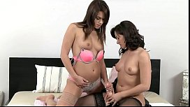 Lesbian babes in stockings fucking with strap on