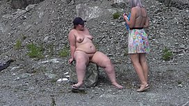 A lesbian with a juicy PAWG washes her friend'_s fat pussy, and then licks her cunt, makes cunnilingus until a clitoral orgasm. Oral sex outdoors.