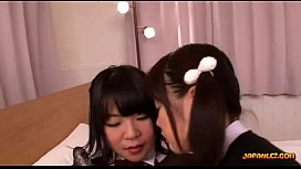 2 Schoolgirls Sucking Vibrator Kissing Rubbing Tits On The Bed In The Room