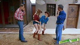 Cowboys slide their rods inside the gals tight holes making them moan in delight