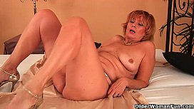 Plump grandma fucks her toy boy'_s cock with her unshaven pussy