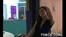 This playgirl gets horny and masturbates while smoking porn vid