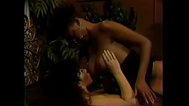 Brunette with hairy cunt gets fucked by ebony lesbian using dildo on bed