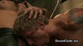Bound gay giving blowjob...