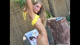 Skinny blonde stripping outdoors...