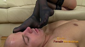 Gina wears black stockings while strokes cock with her feet