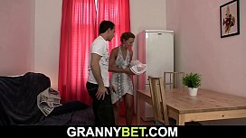 Skinny granny masseuse gets banged from behind