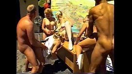 Blonde big tits chick getting pussy fucked with a strap-on from a naugthy girlfriend