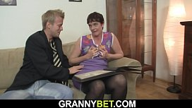 Hairy pussy mature woman in black stockings rides his meat