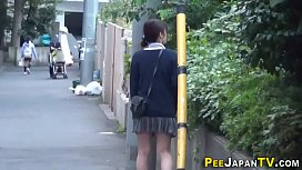Asian babe pees publicly...