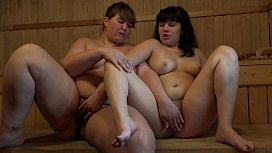 Chubby hairy lesbians fingering in a sauna to orgasm, Russian petting.