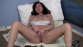 Young looking milf plays...