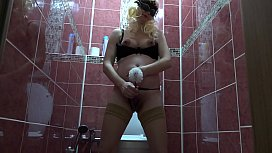 Pregnant milf in stockings first cleans the toilet bowl, and then with a toilet brush fucks hairy pussy. Fetish masturbation.