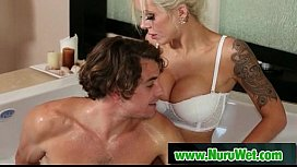 Busty masseuse gives pleasure during massage 11