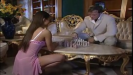 Hot brunette playing chess...