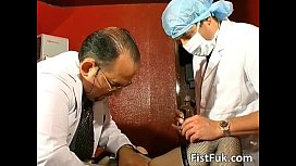 Two gynecologists screw mature...