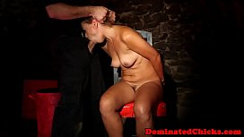 Submissive slave handcuffed and nailed