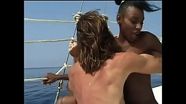 Dark skinned beauty gets her pussy filled with white cock on his boat